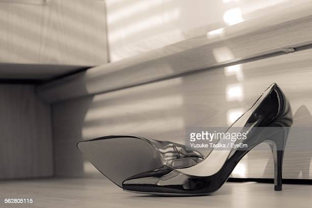Close-Up Of High Heels On Floor