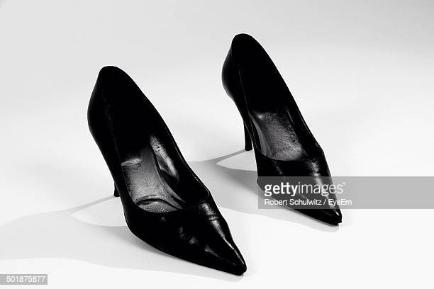 Close-up of high heels shoes over white background