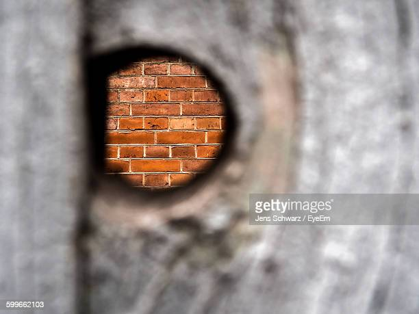 Close-Up Of Hole On Wooden Fence