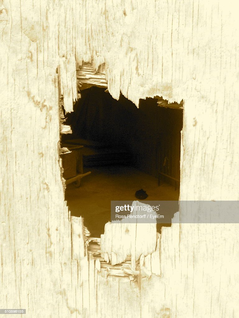 Close-up of hole on wooden wall
