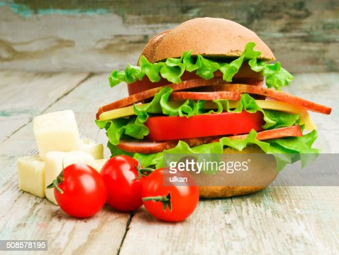 Closeup of homemade hamburger with fresh vegetables : Stock Photo