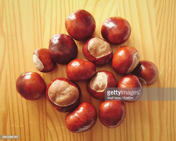 Close-Up Of Horse Chestnuts On Wooden Table