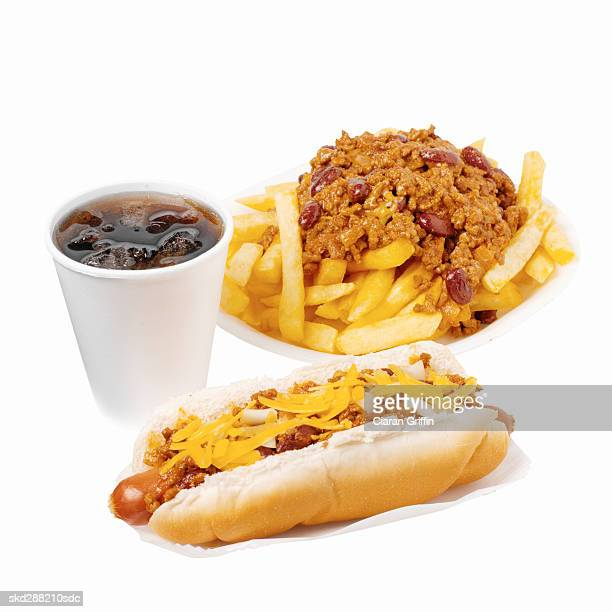 Close-up of hotdog and chili french-fries with cold drink