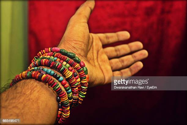 Close-Up Of Human Hand With Bracelets