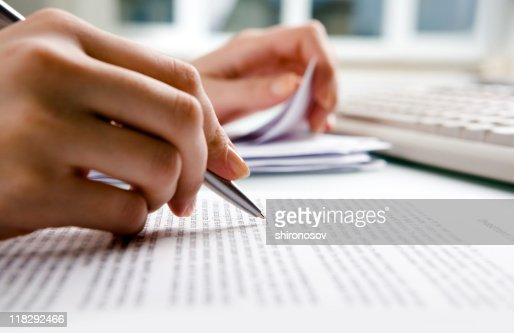 Close-up of human hands doing paperwork : Stock Photo