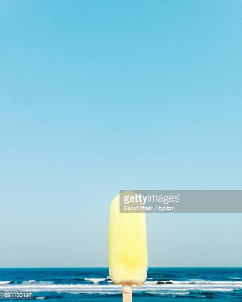 Close-Up Of Ice Cream By Sea Against Clear Sky