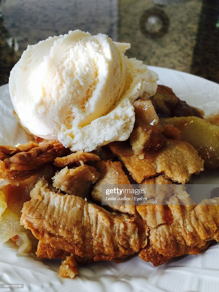 Close-Up Of Ice Cream On Apple Pie Served In Plate On Table