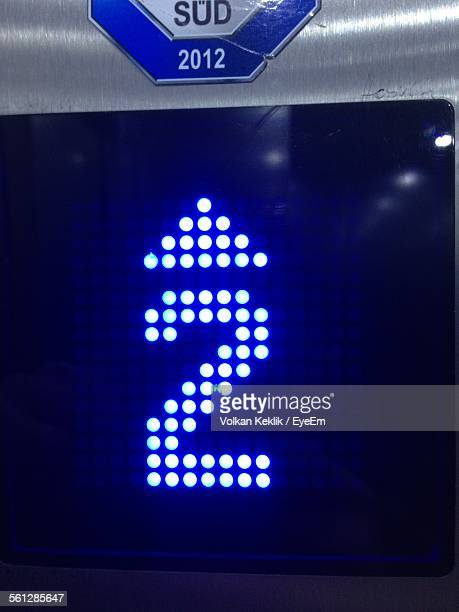 Close-Up Of Illuminated Blue Number 2 Button Of Elevator