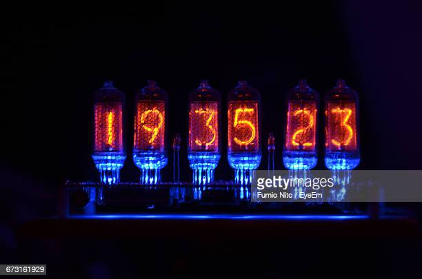 Close-Up Of Illuminated Digital Clock In Darkroom