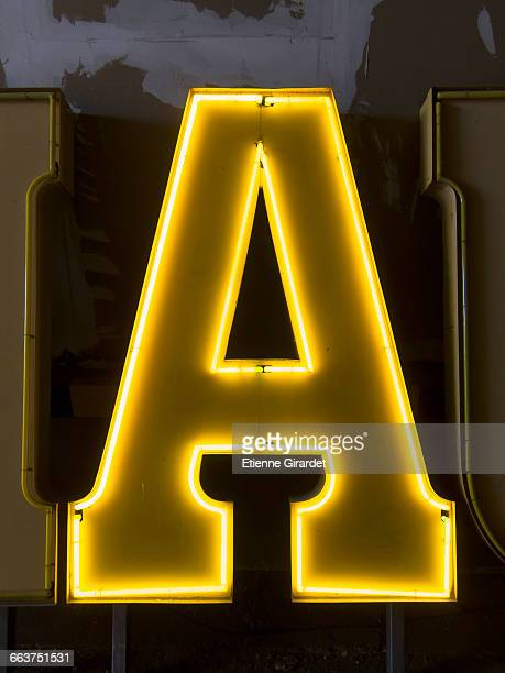 Close-up of illuminated letter A