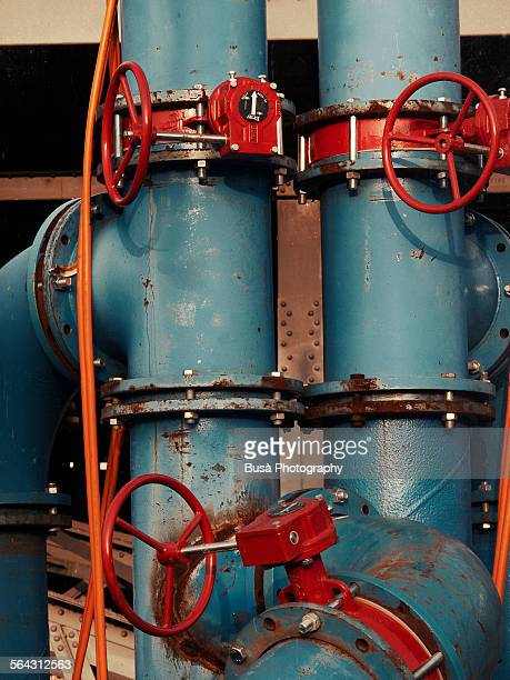 Closeup of industrial pipes with iron valves