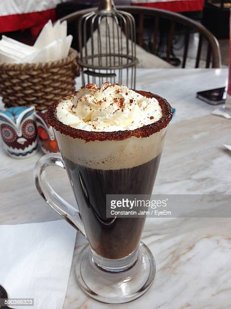 Close-Up Of Irish Coffee Served On Table