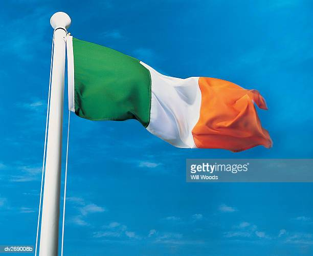 Close-up of Irish flag waving in the wind