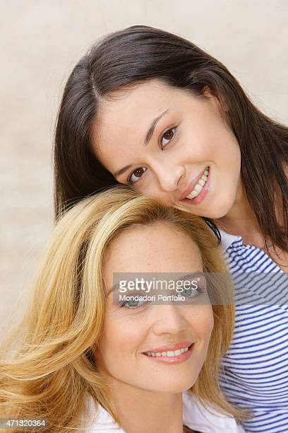 Closeup of Italian actresses Francesca Cavallin and Marta Gastini smiling in a photo shooting on the set of the TV miniseries 'L'uomo che cavalcava...