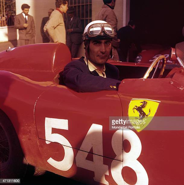 Closeup of Italian driver Eugenio Castellotti seated inside his Ferrari before the third trial of XXIII Mille Miglia Brescia 28 April 1956