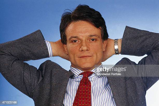 Closeup of Italian singer and theatre actor Massimo Ranieri keeping his hands behind the head Photo shooting Italy 1988