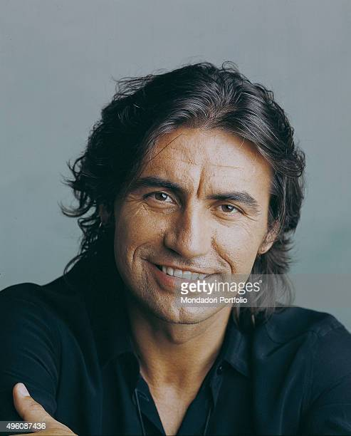 Closeup of Italian singersongwriter Luciano Ligabue posing smiling during a photo shoot Italy