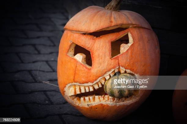 Close-Up Of Jack O Lantern On Footpath During Halloween