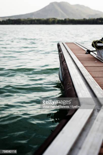 Close-Up Of Jetty On Lake Against Sky