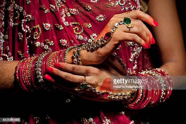 Close-up of jewelery on hands of Indian bride