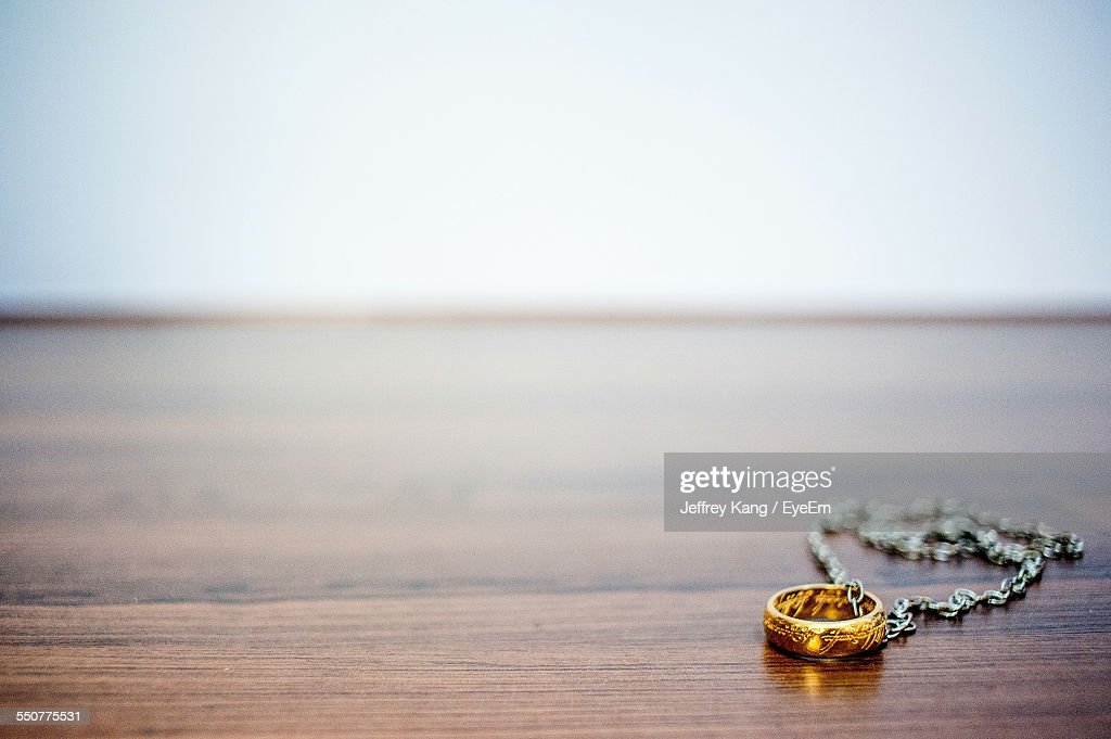 Close-Up Of Jewelry On Table At Home