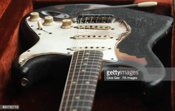 A closeup of Jimi Hendrix's 1965 Fender Stratocaster the first guitar burnt on stage by the rock icon on display at the Idea Generation Gallery
