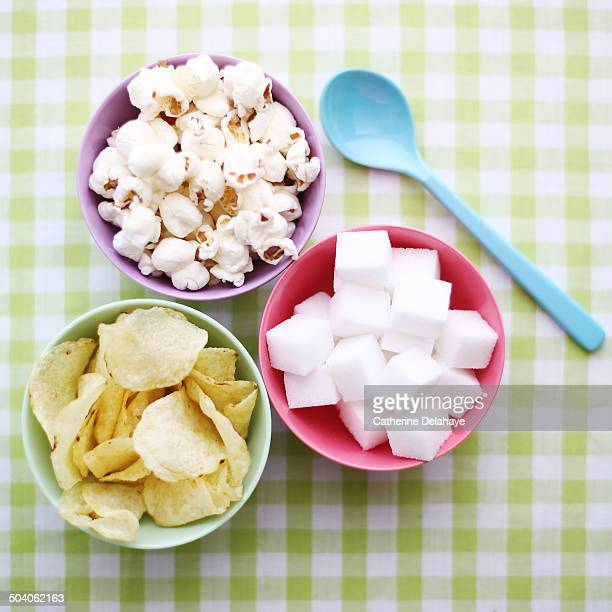 Close-up of junk food in baby bowls
