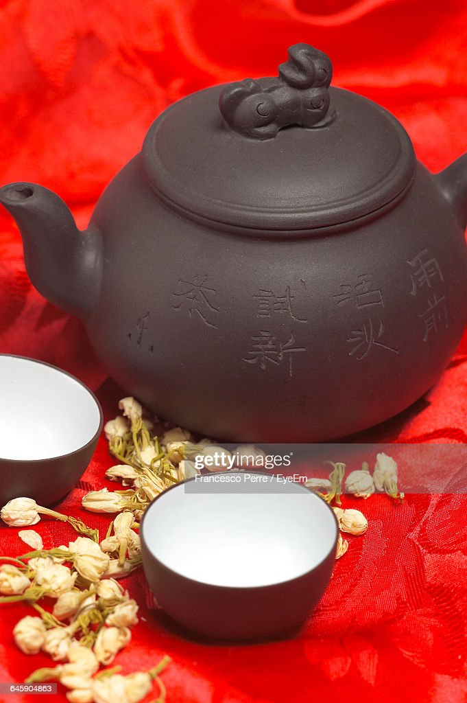 Close-Up Of Kettle With Bowls On Table