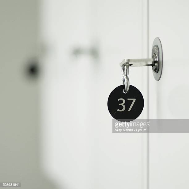 Close-up of key at door against blurred background