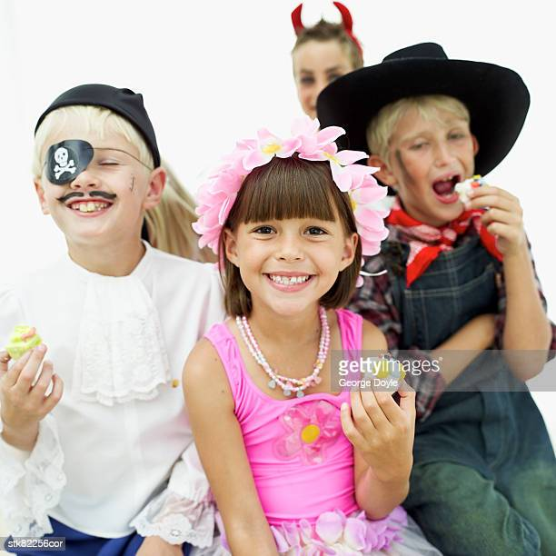 close-up of kids dressed up in costumes at a party