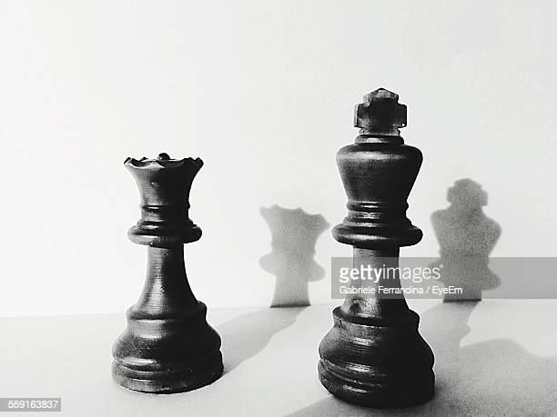 Close-Up Of King And Queen Chess Pieces On Table