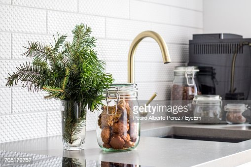 Kitchen Counter Close Up closeup of cookie jar on kitchen counter stock photo | getty images
