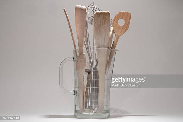 Close-Up Of Kitchen Utensils Against White Background