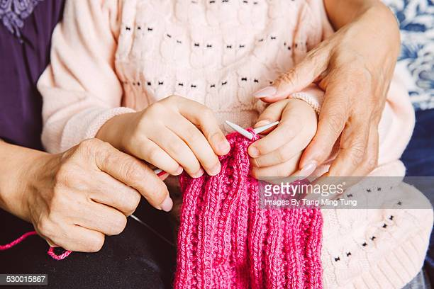 Closeup of knitting hands of grand daughter