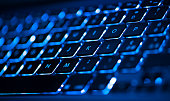 Closeup of laptop keyboard illumination, backlit keyboard
