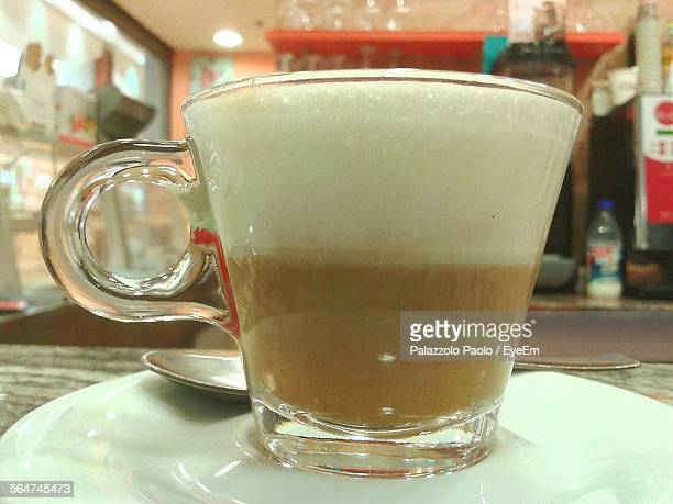 Close-Up Of Latte Macchiato On Table In Restaurant