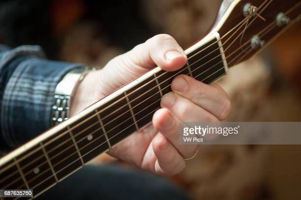 Closeup of left hand of guitar player holding a chord in Easton MD