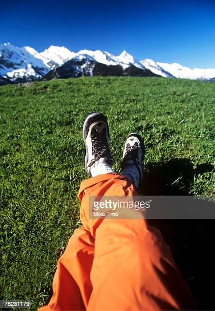 close-up of legs in front of mountain landscape