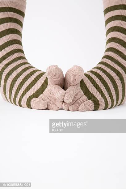 Close-up of legs in striped socks