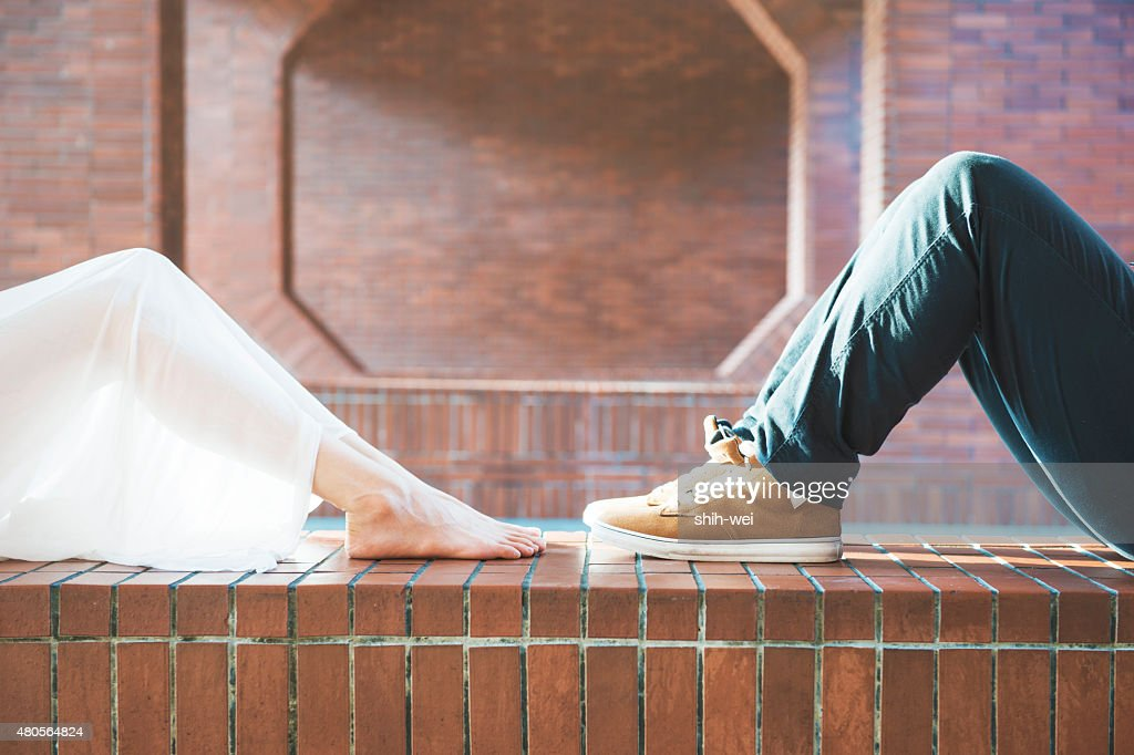 Close-up of legs of the kissing couple : Stock Photo