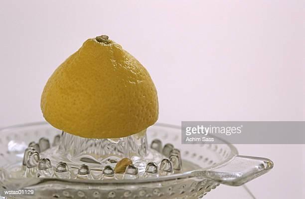 Close-up of lemon half on juicer