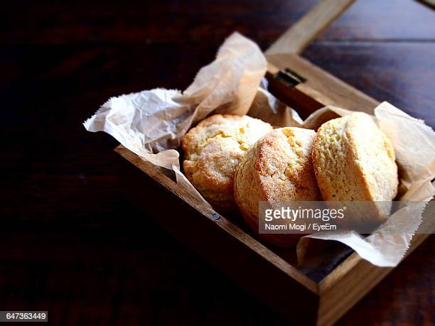 Close-Up Of Lemon Scones In Wooden Box On Table