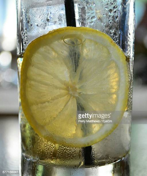 Close-Up Of Lemon Slice In Glass Water