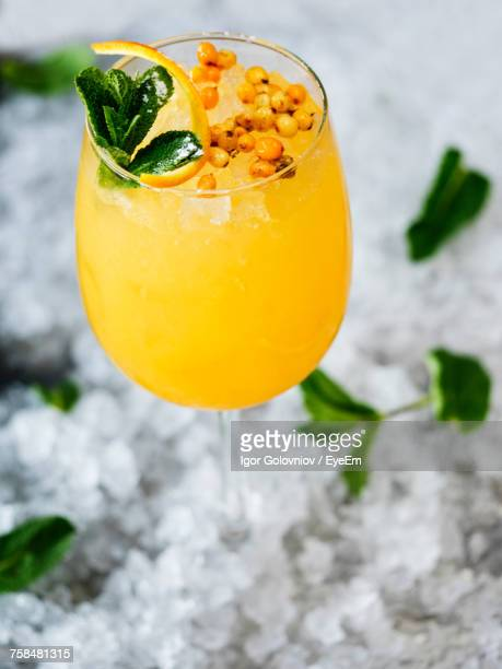 Close-Up Of Lemonade Garnish With Sea Buckthorn In Glass On Crushed Ice
