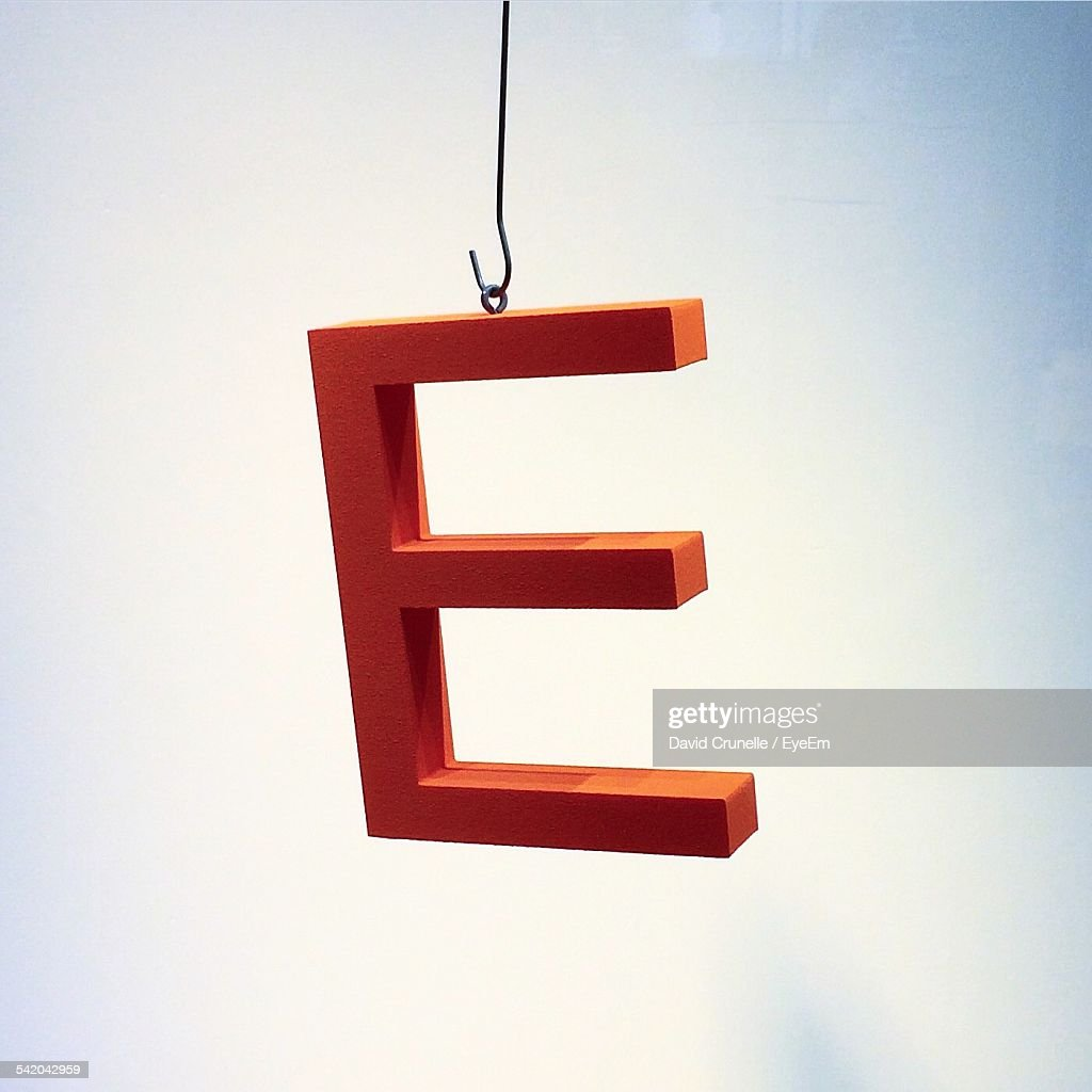 Close-Up Of Letter E Against White Background
