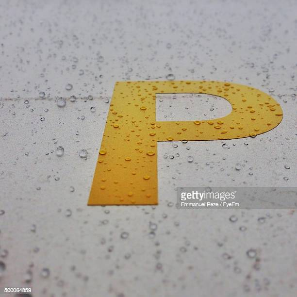 Close-up of letter P on wet floor