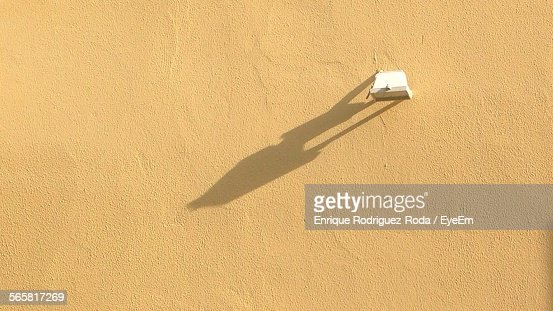 Close-Up Of Light Fixture On Stucco Wall