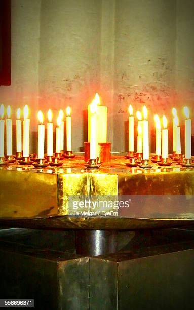 Close-Up Of Lighted Candles