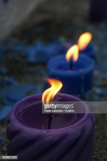 Close-Up Of Lit Candles At Dusk