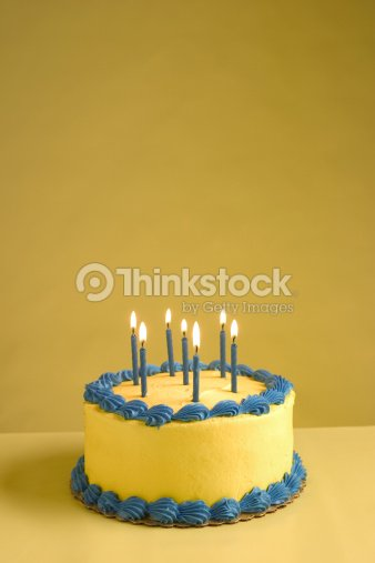 Close Up Of Lit Candles On A Birthday Cake Stock Photo